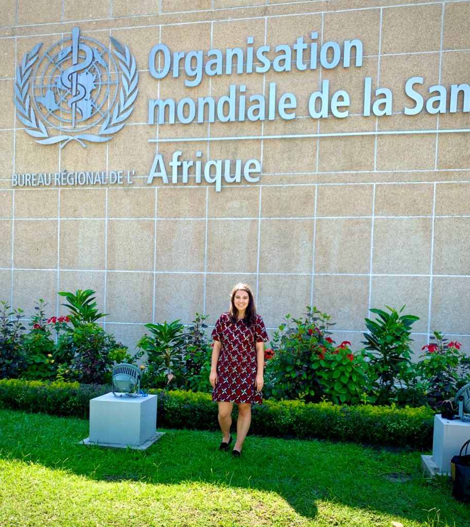 Luisa Ferrari poses in front of flowers at the WHO regional office in the Republic of the Congo