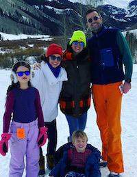 Elizabeth Ann Keating with family, including husband Kevin Keating (B'01) in front of a snowy mountain