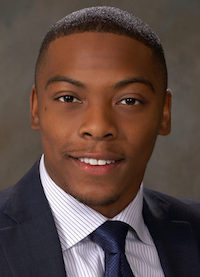 Raynard Ware in an official portrait style photo.
