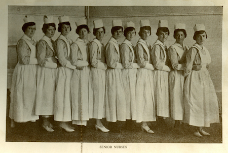 An image of the senior nursing class in their student nursing uniforms in a line from the 1920 Ye Domesday Booke yearbook.