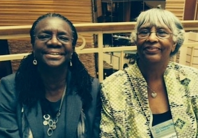 Dr. Edilma Yearwood and Dr. Bernardine Lacey pose for a photograph in 2014 during the American Academy of Nursing meeting.