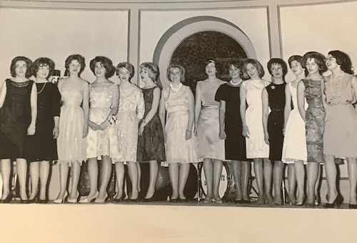 A group of Georgetown nursing students in formal attire in the late 1950s or early 1960s at a singing performance