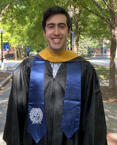 Joseph Maccarone, in his graduation gown and stole with the university seal, on Georgetown University's campus