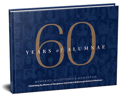"""A photo of the new book """"60 years of Alumnae"""" featuring women graduates of Georgetown's business school."""