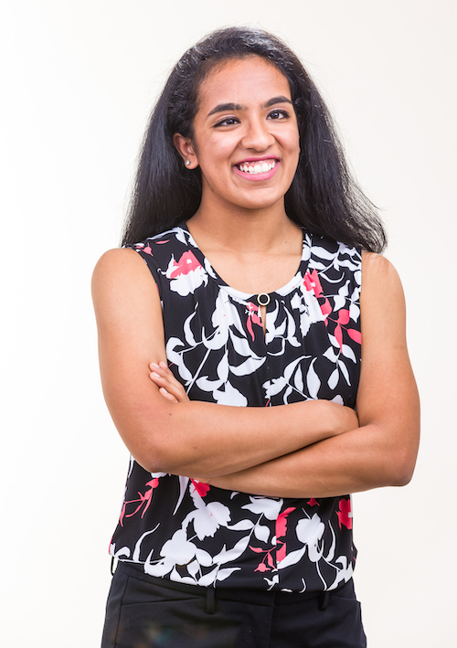 Global health major Shreyaa Venkat in a photograph standing in front of a neutral background.