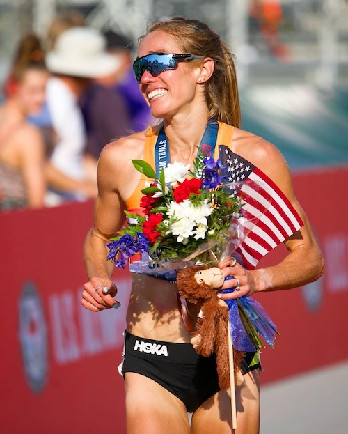 Rachel Schneider carried a flag of the United States and flowers