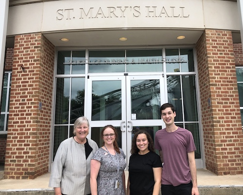 Standing in front of St. Mary's Hall, the home of the School of Nursing & Health Studies are: Dr. Diane Davis, Vanessa Taylor, Halyn Orellana (NHS'22) and JoJo Farina (C'23)